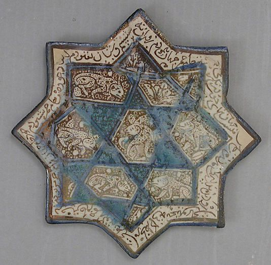 Star-Shaped Tile Object Name: Star-shaped tile Date: 14th century Geography: Iran, Kashan Culture: Islamic Medium: Stonepaste; underglaze painted Classification: Ceramics-Tiles Credit Line: Fletcher Fund, 1971 Accession Number: 1971.235.1