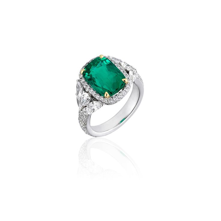 A Natural Beauty. Cushion Cut Colombian Emerald combinated with Marquise and Brillant Cut Diamonds.