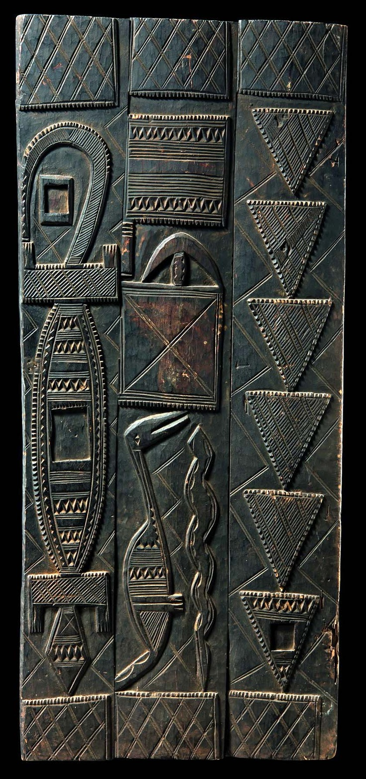 Africa | Door from the Nupe people of Nigeria | Wood, with a dark brown patina