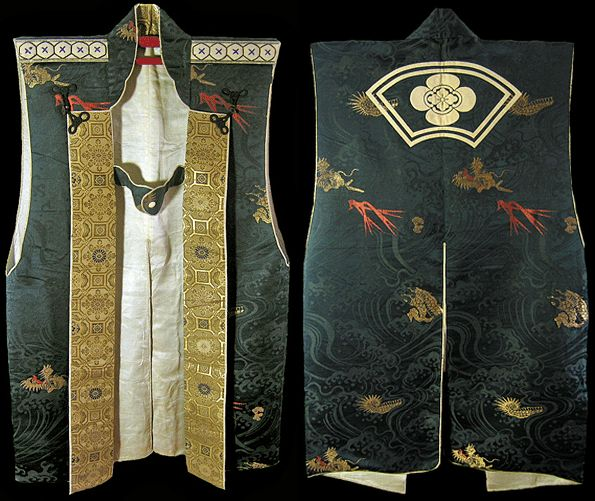 Jinbaori,  only the finest of materials were used both domestic and imported. The mon is of the Mokko style. It was used primarily among the Asakura and Oda Clans. As is usual for surcoats, the armholes are very deep to allow the garment to be worn over armor; at the back is a slit for ease in sitting or riding a horse. This is a very fine Daimyo grade example of a period Jinbaori.