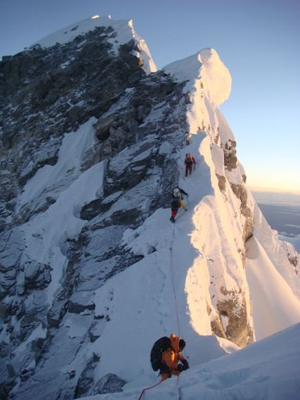 As the sun crested the horizon, our team slowly picked its way along the summit ridge en route to Everest's summit.