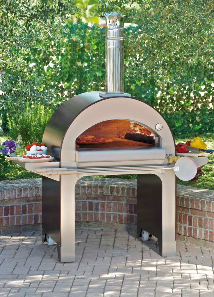 i would love to own this pizza oven omg i would make soooo many