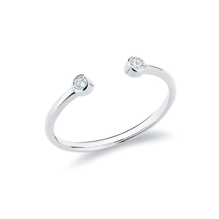 Twin ring set with diamonds in 18K white gold.