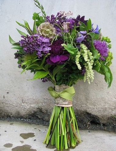 Purple flowers bridal bouquet. I also like this wild flower look; maybe for center pieces or other decor more than bridal party bouquets
