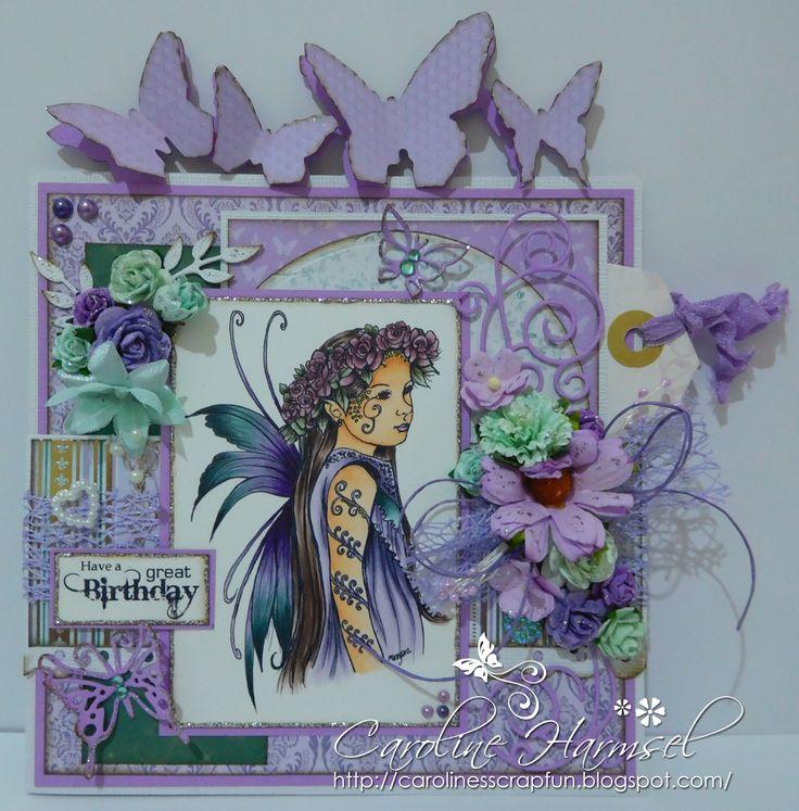 Digi stamp 'Fae 28'. Copic colours used: Skin: E0000, E000, E01, E11, E93 Hair: E70, E71, E74, E77 Dress: V20, V22, V25, V28, BG70, BG72, BG75 Wings: V09, V22, V25, BG72, BG75, BG78 Flowers: RV91, RV93, RV95, RV99 Leaves: BG90, BG93, BG99 Tattoos: Spica pen 05 Lemon, 13 Lilac
