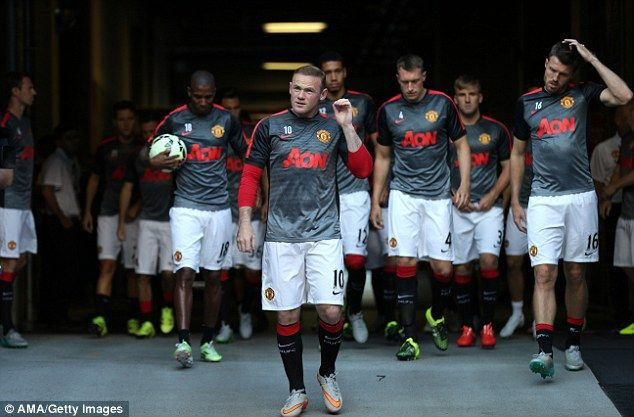 Rooney leads out his United team-mates for training at CenturyLink Field in Seattle earlier this week