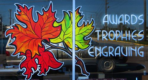 https://flic.kr/p/Mf1w58 | Autumn Leaves Window Painting | Local trophy shop promoting awards, trophies, and engraving with fall leaves window painting