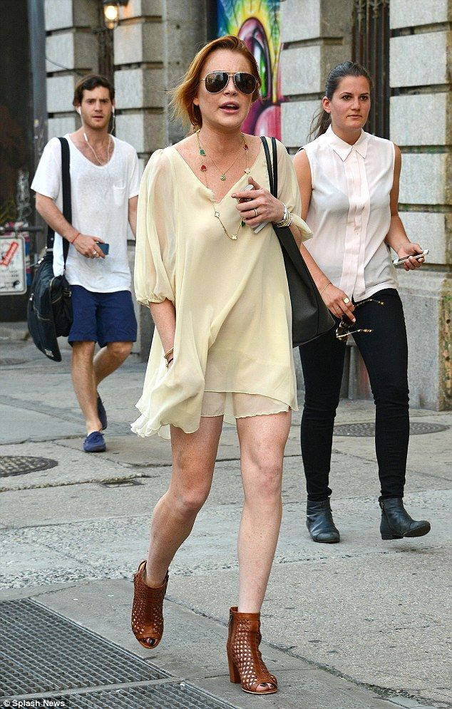 Back in the USA: Lindsay Lohan showed off her long legs in a neutral mini dress in New York on Tuesday