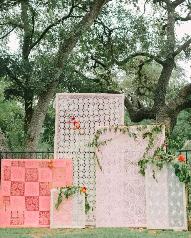 Backdrop for the altar at a wedding made with vintage lace tablecloths.
