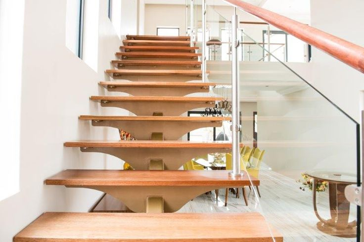 sans compliant mild steel single stringer with timber treads and stainless and glass balustrades