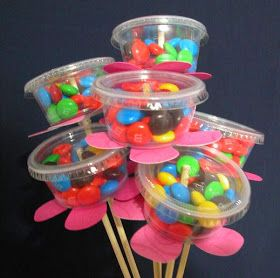 I made these Candy Bouquets for my May Day baskets. I bought the Multi Purpose Mini Cups and lids from Walmart in the paper plate section....