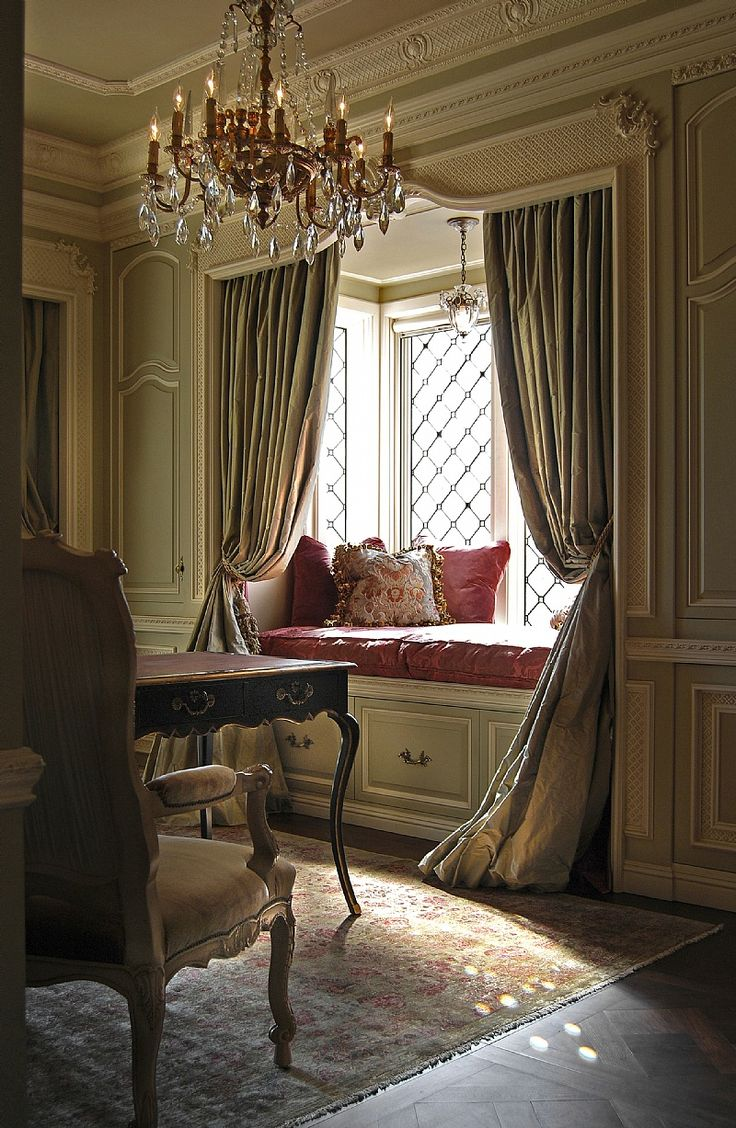 Window Seat Design ~ love the drape of the curtains and the moldings. There is even a light above the window seat for reading.