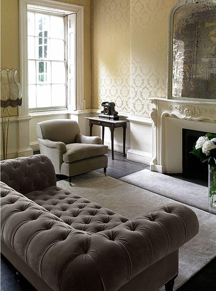 grey chesterfield sofa, single armchair and soft rug