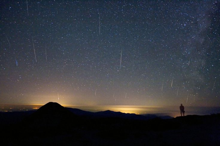 Tudorica Image of 2008 Perseid Meteor Shower - A mountain top above the clouds and light-polluted cities of Romania served as a good spot from which astrophotographer Alex Tudorica could watch the 2008 Perseid meteor shower.
