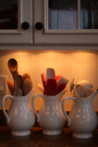 white pitchers to hold your cooking utensils instead of being shoved in the drawers.