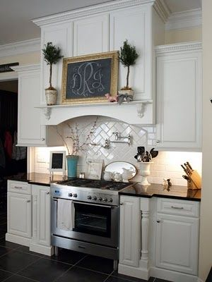 Really like that mantel above the stove-and the cupboards are functional behind the decor too.