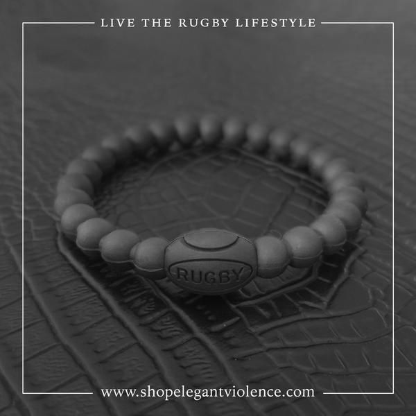 A stylish, subtle way to carry a piece of rugby with you wherever you go! Black Silicone version of the Rugby Ball Bracelet to wear in the toughest conditions. Take it to workout, on a hike, a bike ride, karate class, and of course, onto the pitch! The sky is the limit and don't worry about it breaking!   SIZING  17cm Usually fits teenage boys and girls.   19cm Usually fits the average man and women who like a looser fit