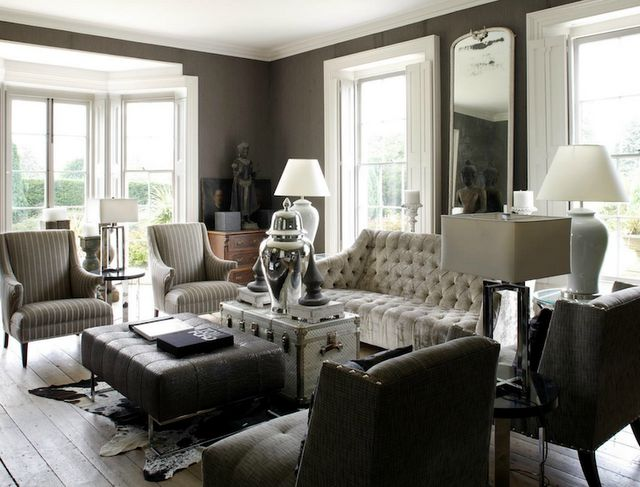This elegant and refined living room was designed with - Grey and black living room pictures ...