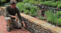 How to Build a Retaining Wall on Uneven Ground   eHow