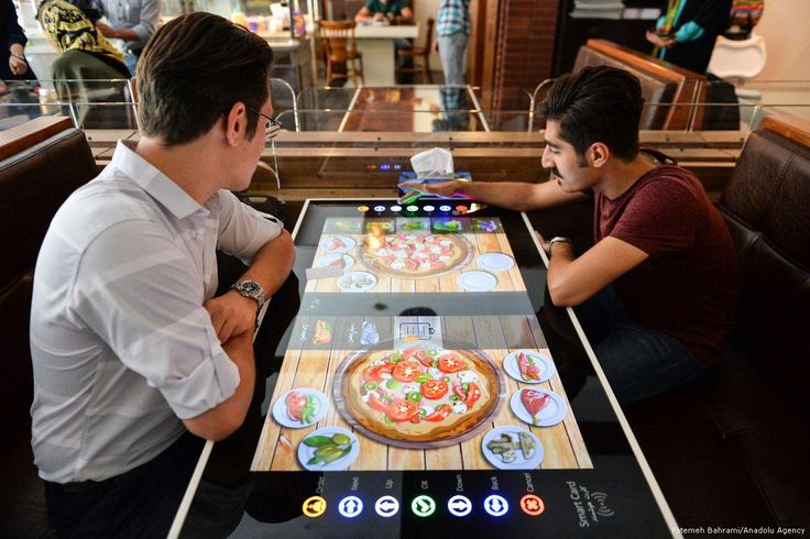 All services including payment, placing an order, are provided automatically via tables, which turn to digital screens like an tablet computer, at 'RoboChef' ...