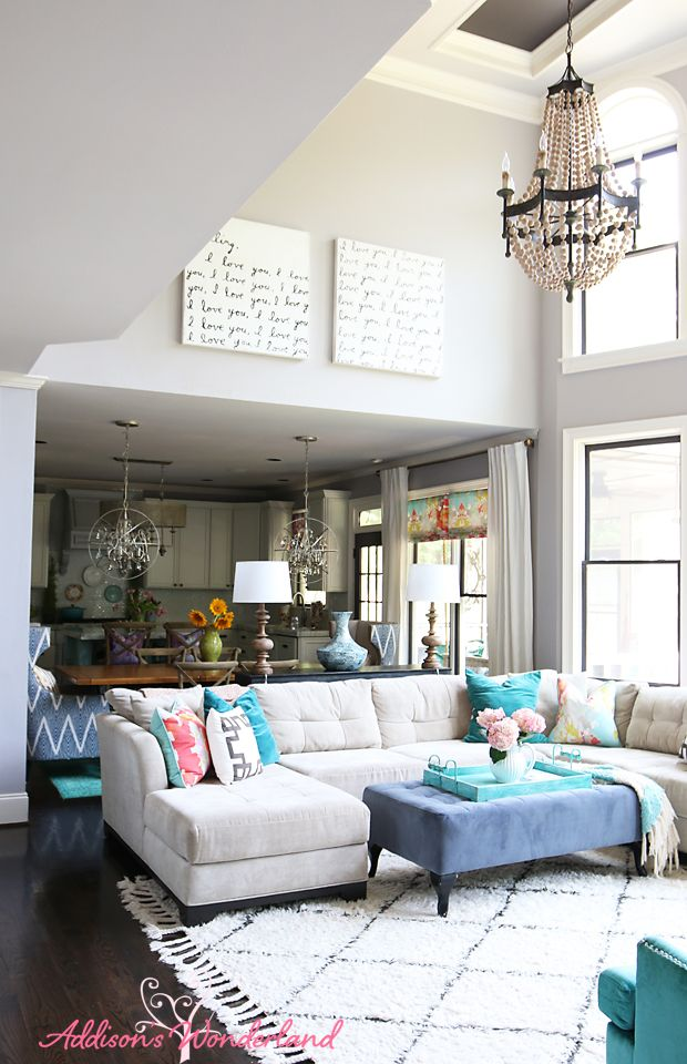 decorating the wall in a two story living room