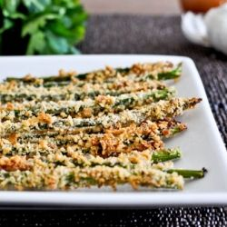 Crispy Parmesan Asparagus Sticks 1 bunch of asparagus (mine had about 30 spears)    2 egg whites    1/4 cup flour (I used whole wheat pastry flour)    1 cup seasoned panko breadcrumbs    1/4 cup parmesan cheese    salt and pepper    Preheat oven to 425 degrees.