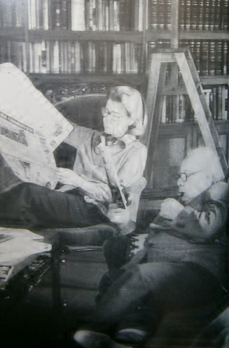 J B Priestley in his library