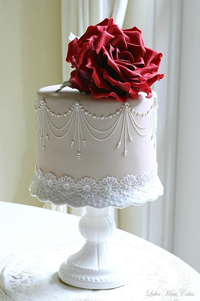 Delicate pink peony ruffles, striking rose sugar flowers, exquisite piped lace patterns,hand-painted teddy with roses, gloves and lace,these brilliant wedding cakes fromLeslea Matsis Cakes are too pretty to eat!