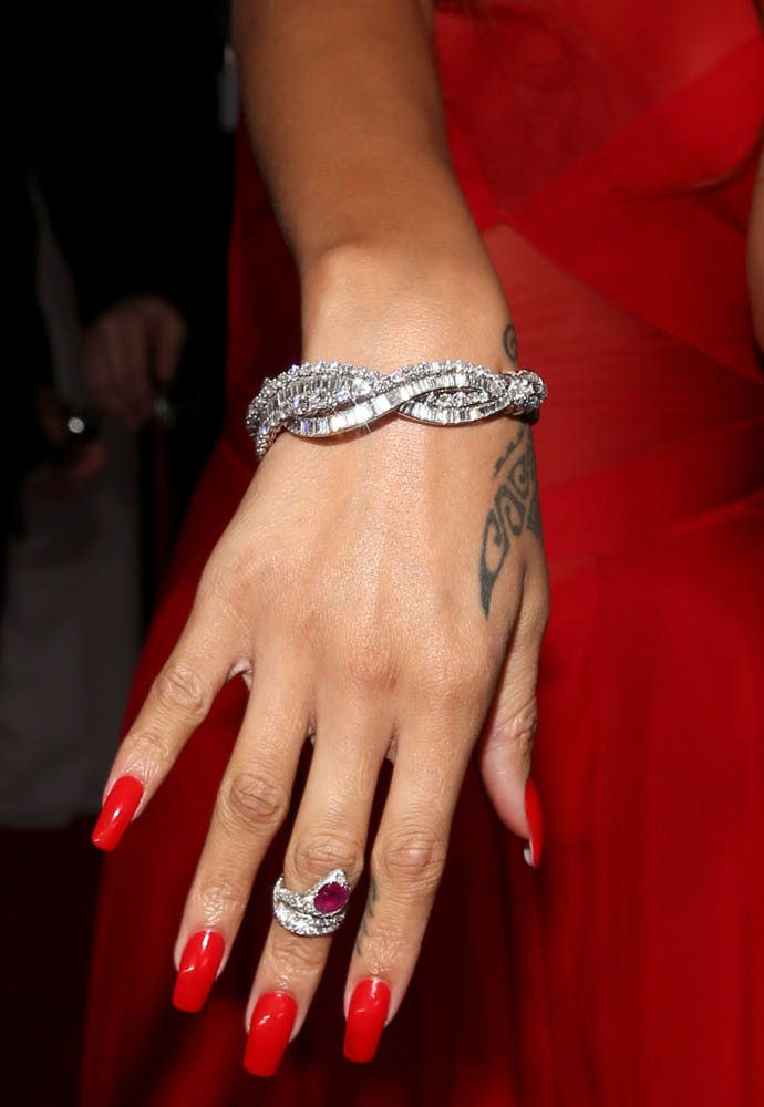 Rihanna's red nails in a red custom Azzedine Alaia dress and Neil Lane diamond jewelry