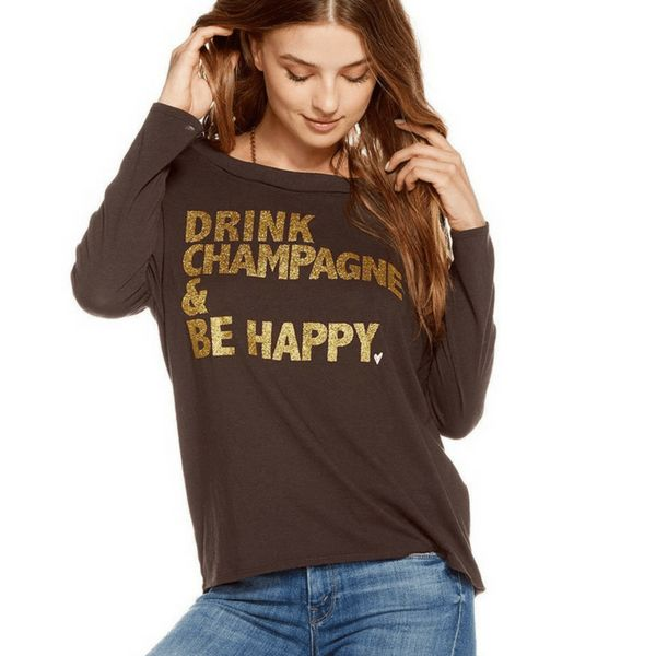 """Drink Champagne Be Happy Pullover. If only everything in life was this straight forward. This festive black pullover by Chaser will replace your typical sweat shirt  post workout. Featuring """"Drink Champagne Be Happy"""" lettering in a gold  shimmer print, this pullover has unique detailing that will make it one  of your faves. Shop now at https://www.simplyworkout.com/ #workoutwear #inspiration #motivation"""
