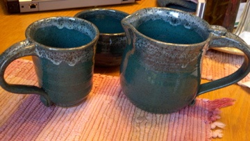playing with turquoise glaze with metallic green dipped rim...kinda like it!