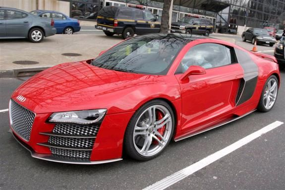 Tom Brady driving his gorgeous red Audi