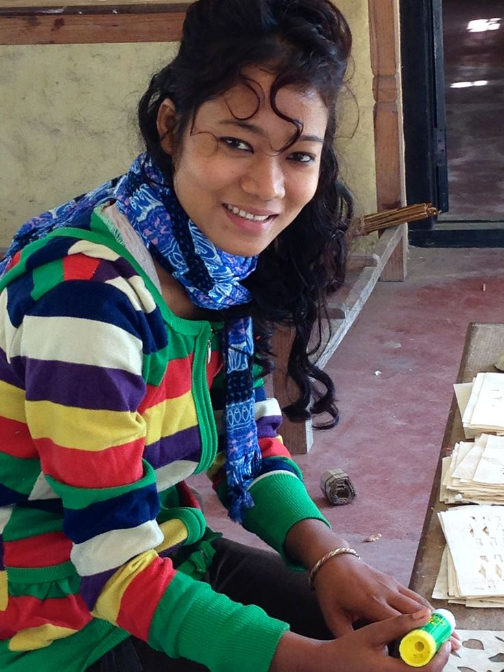 Neva from Sapana Women's group in Nepal making our handmade paper notebooks.