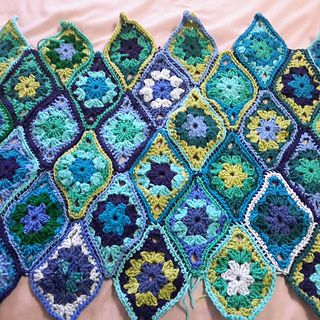 "I am not a fan of granny squares usually but I saw a picture of Jane Crowfoots pattern for Chinese Lantern shaped granny ""squares"" and decided to create my own. I named this pattern after my son Tom who has always made me proud to be his mom."