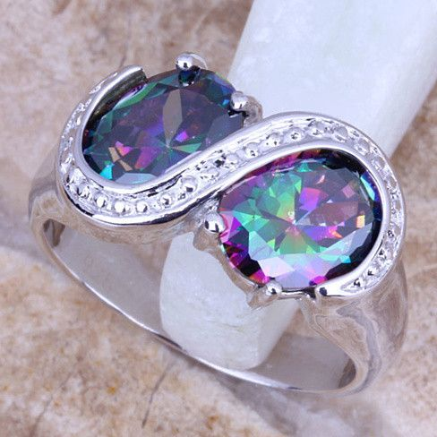 """Fire To Infinity Ring - """".925 Sterling Silver ring featuring two large Rainbow Mystic topaz stones with white topaz accents. Ring is available in sizes 6,7,8,9."""""""