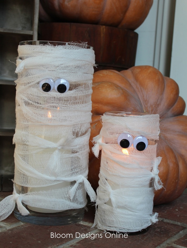 Mummy lanterns. I used gauze and a couple garage sale stickers with pupils drawn on for eyes. Total cost: nothing!