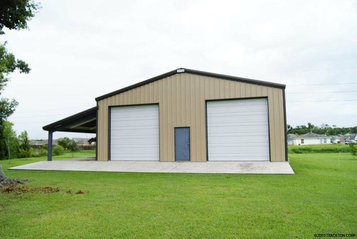 steel garage building with two high overhead doors and a leanto on the side steel garages pinterest steel garage buildings steel garage and