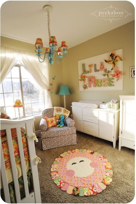 Adorable Beige Nursery with Rainbow Accents