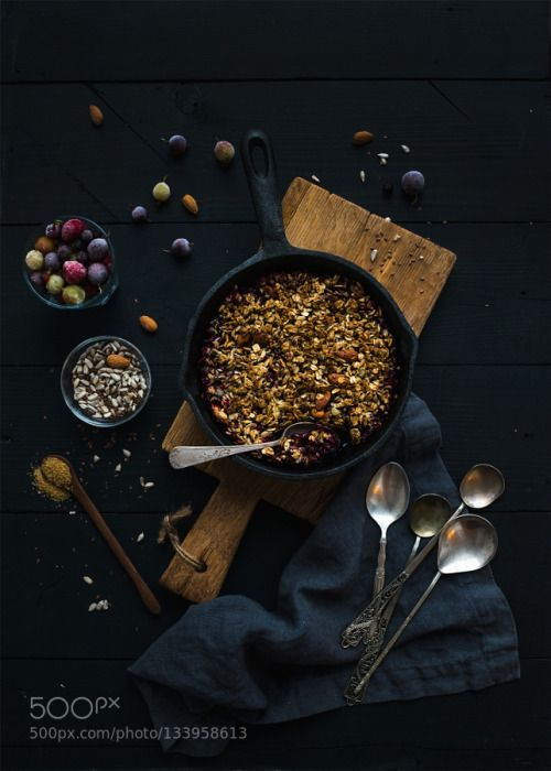 Healthy breakfast. Oat granola crumble with frozen fresh berries and seeds in irom skillet pan on r by 2enroute  IFTTT 500px almonds baked berry black blackcurrant blueberry breakfast cereal closeup cobbler cook