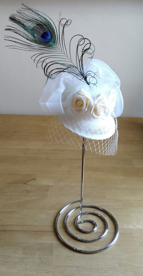 Hey, I found this really awesome Etsy listing at https://www.etsy.com/uk/listing/269948642/cream-fascinator-hat-with-peacok-feather