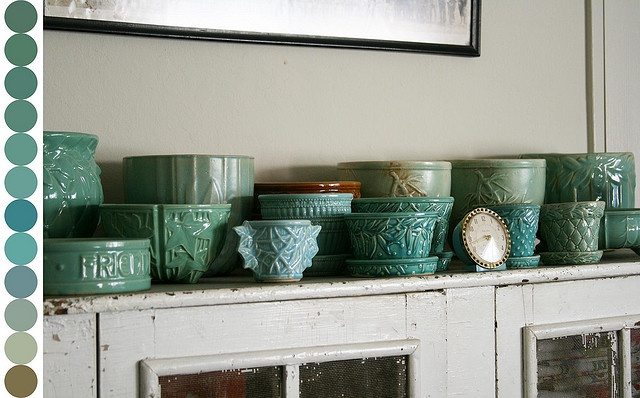 Love the display.  Green McCoy on an old white cabinet!