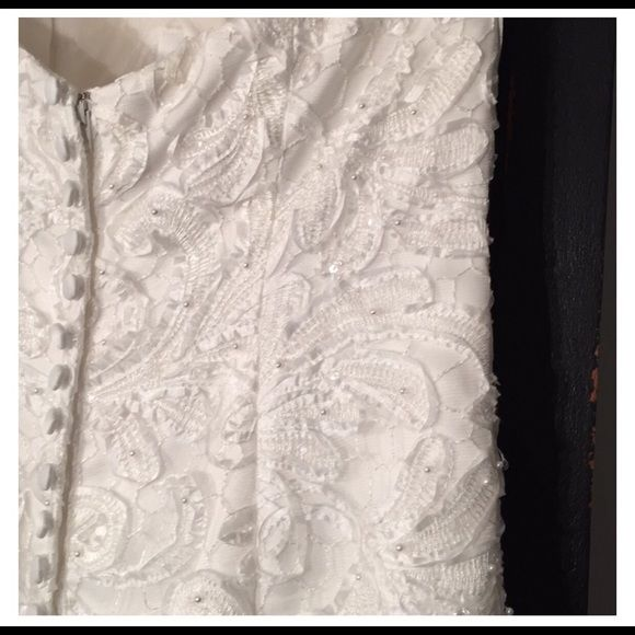 Galina Signature wedding gown Beautiful off white galina signature trumpet gown. Size two. Now signs of wear and tear. Worn once. Need out!! Dresses