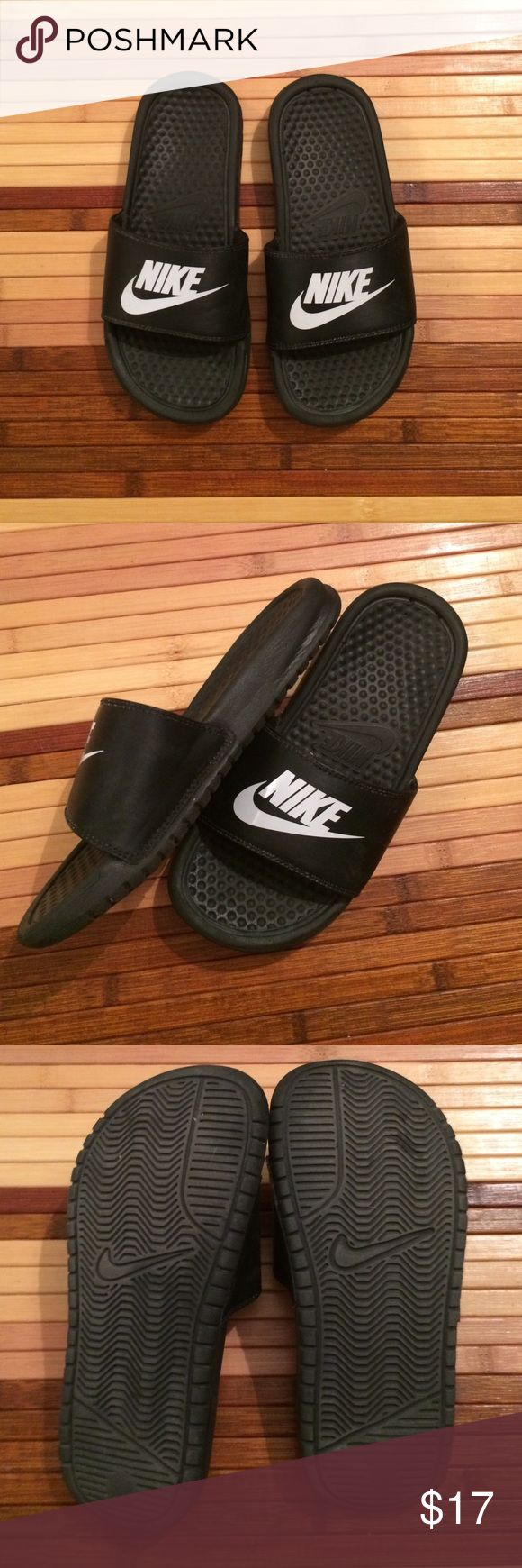 Kids Nike Slides Boys or girls Nike shoes! Great year round in the summer or winter after a ball game! Gently used.  Nike Shoes Sandals & Flip Flops