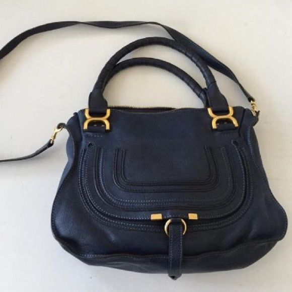 Gorgeous Chloe Marcie Medium Cross Body in Navy Preloved but in excellent condition - minor wear to cross body strap edges and a black nail polish stain on inside bottom lining. Price reflects. Navy leather is gorgeous. Leather is soft and thick. Gold hardware. Handles in great condition. Color is in stores now. More photos coming. Chloe Bags Crossbody Bags