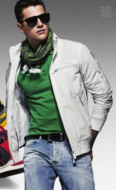 Men's eggshell lightweight bomber paired w/ kelly green polo shirt, scarf, cool black sun glasses & Armani jeans.
