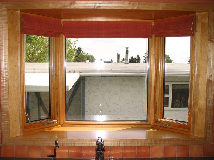 Metal clad exterior with wood interior.