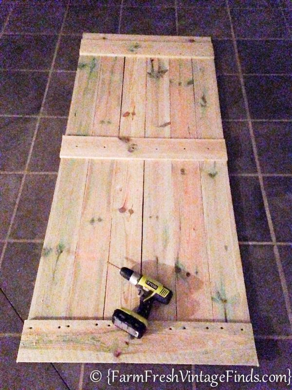 hometalk how to build and hang a barn door for around 20