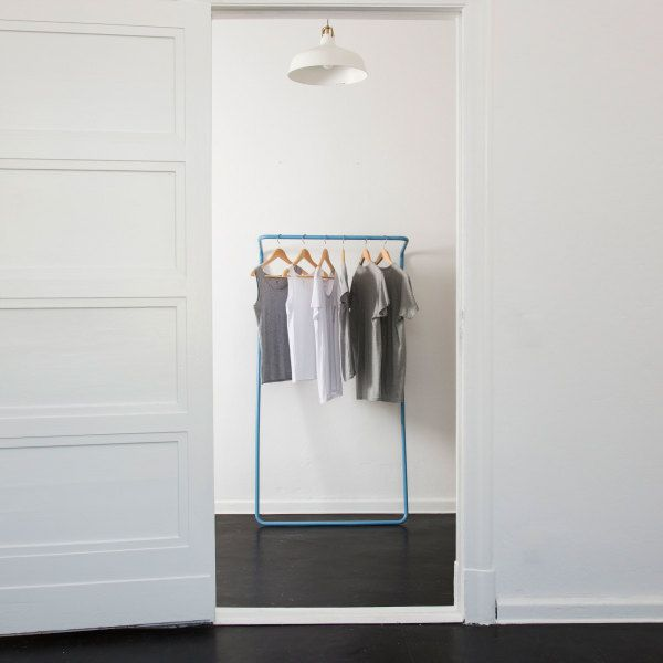 """Dictionary definition of minimalism. """"Untitled Rail"""" leaning closet in blue, white or black powder coated on steel tubular, two sizes.  By UK Untitled Story."""