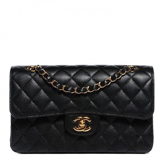 This is an authentic CHANEL Caviar Quilted Small Double Flap in Black. This stylish petite shoulder bag is crafted of textured leather.