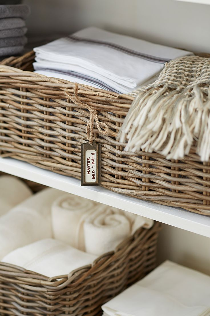 How to Organize a Linen Closet: Once you've purged, sorted, and organized, create a system in either your linen closet or a storage armoire that helps you stay organized. Some of our favorite tips include using baskets to group like items with like. This way you can keep items organized by room or bedding size.